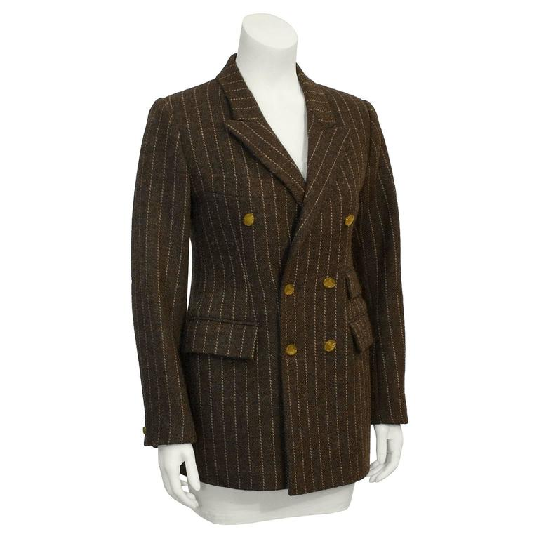 British punk designer Vivienne Westwood's wool blazer from the 1980's. Heavy weight brown wool, with beige pinstripes. Two flap pockets on right waist, one on the left waist and a slash breast pocket on the left. Double breasted, with mustard