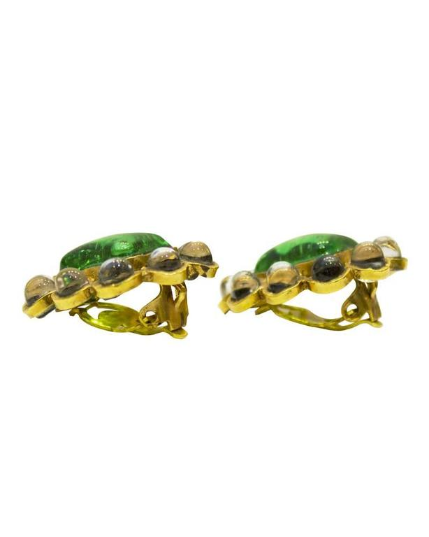 Attributed to Gripoix for Chanel Couture poured glass and gold plated clip on earrings. Unusual color combination of emerald green and pinkish clear glass. Hand wrought feeling to the workmanship. Circa 1960. Made in France. Excellent vintage