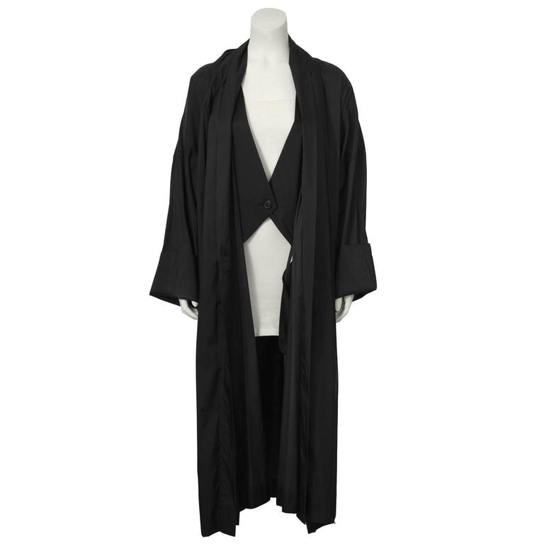 """Amazing 1990's Issey Miyake oversized black nylon Windcoat with a shawled collar, front and interior button closure, and two slit pockets.  Excellent vintage condition. Fit generous, US 4-10.  Length 53"""" 