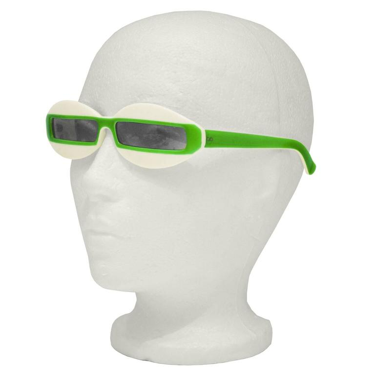 Great looking Italian made Courreges inspired sunglasses from the 1960's. Futuristic style features narrow rectangular lenses on a cream background with a lime green stripe that continues down the arms. In excellent condition. Not prescription.