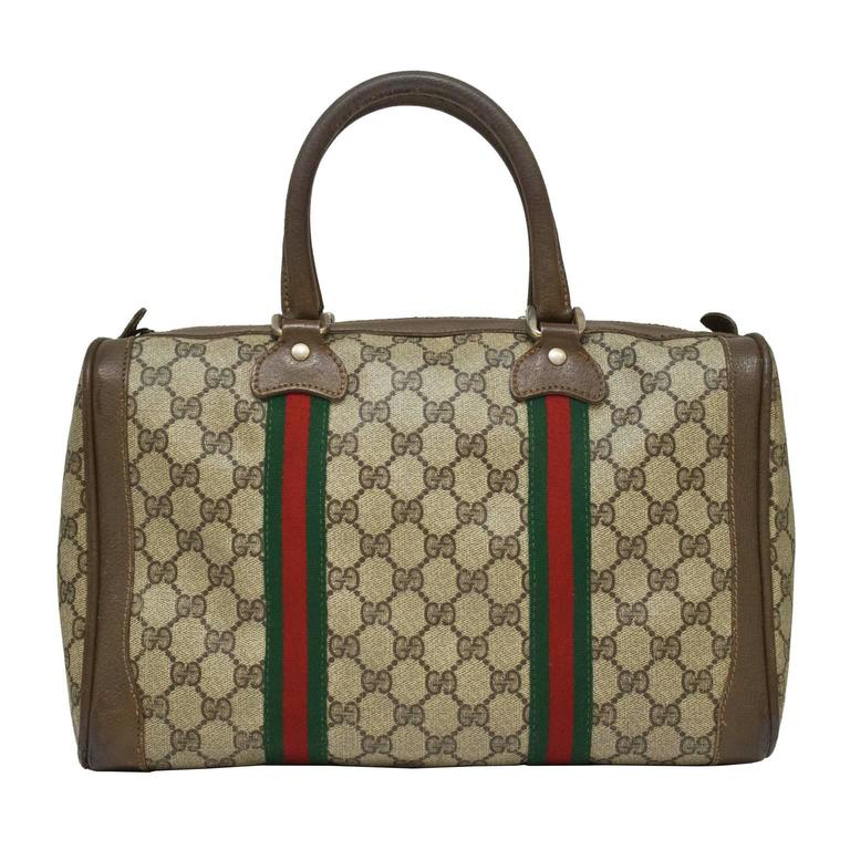 c6ef68dfc45 1970 s Gucci medium size monogram Boston duffle bag. Brown coated canvas is  trimmed in brown