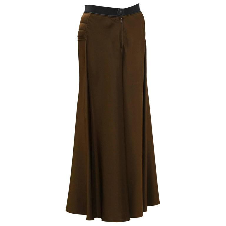 Early 2000's Gaultier brown maxi skirt.  Horizontal quilting details on the hips with a pant style front button and zipper closure. The cotton waistband is fashioned from a standard zipper showing the metal edge. In excellent condition. Fits like a