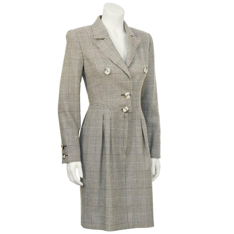 Valentino brown Glen check wool dress from the 1980's. Notched collar, fastens with hidden hooks and short fly zipper with two large buttons on the front. Matching faux tortoise buttons on the cuffs. Slight gather at the waist with inseam pockets on