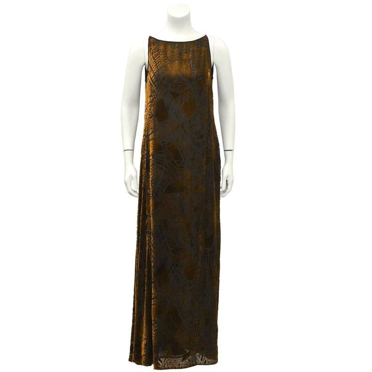 Christian Lacroix late 1980's art deco style bronze and black devoré velvet chemise shaped gown with matching shawl. Sleeveless with boat neckline and skinny non-adjustable shoulder straps. Asymmetrical gather on the right hip. The dress is meant