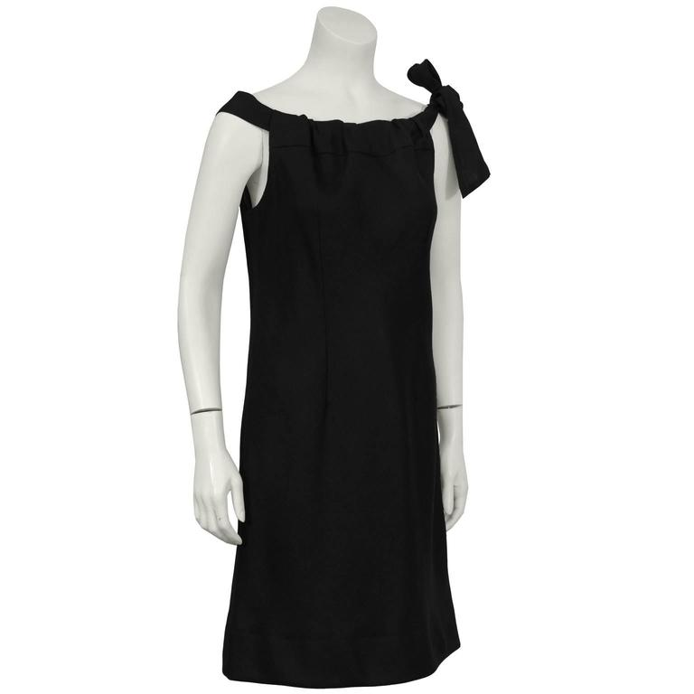 1960's Italian made for HR Boutique black linen sheath sleeveless dress with faux drawstring detail and self-tie over left shoulder. Double seamed front and back. Slightly fitted with a side zip, fully lined. Immaculate condition. Fits like a  US 6.