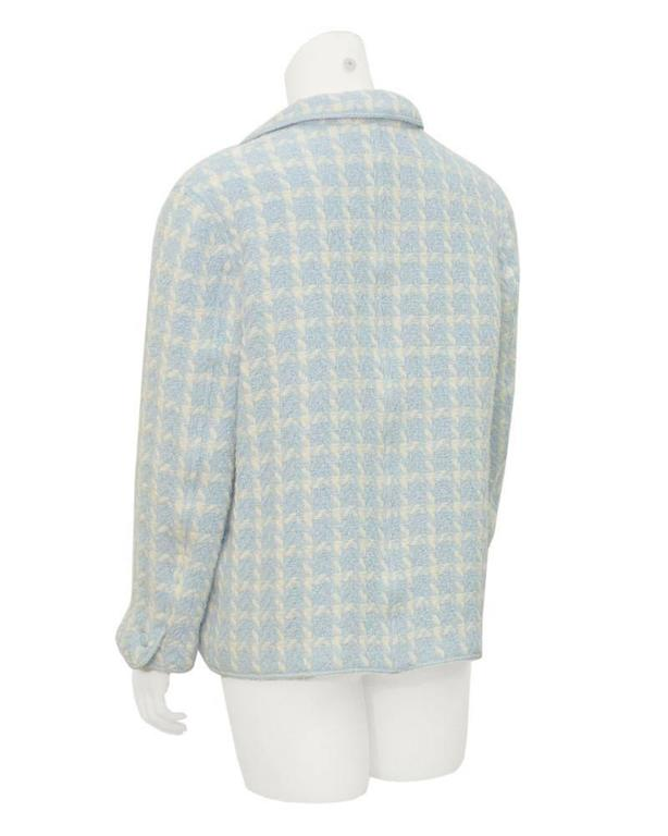 Adorable Chanel baby blue boucle houndstooth jacket from the SS 1996 collection. The rolled lapel and open front makes this jacket the perfect casual piece, ideal for throwing on over jeans and a simple white tee. Top flap pockets on the hips and