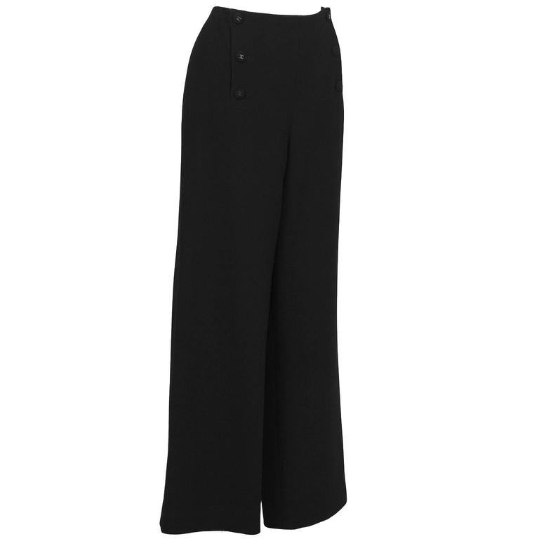 Chanel black sailor-style button front pants from the Fall 1997 collection. The pants feature a wide leg and fastens up the front with 6 fabric covered buttons with gunmetal black cc in the center. In excellent condition. Fits like a US 8-10.