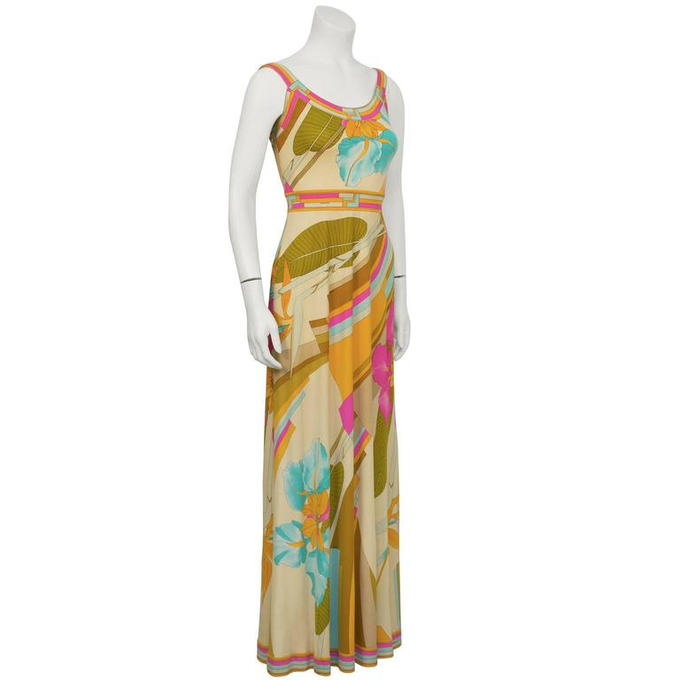 Stunning 1970's pastel pinks, orange and blue Leonard maxi dress with floral and geometric graphic print on soft tan background. Summery U shaped neckline and straps with deep V back and zipper close. LIke similar Pucci pieces it is signed fabric in