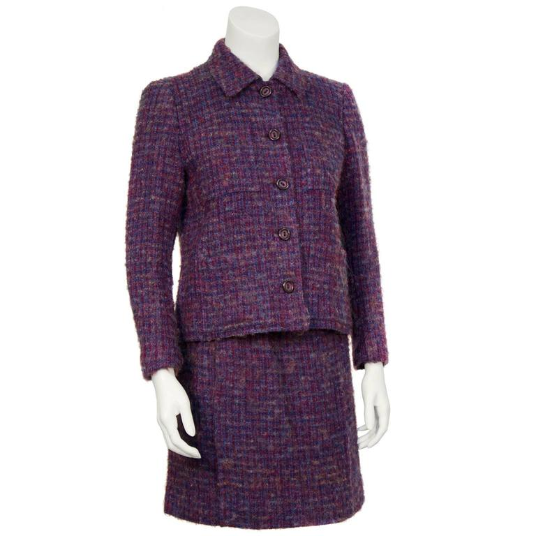 Beautiful Guy Laroche woven wool boucle skirt suit from the 1960's. The jacket has a pointed collar and four patch pockets on the front. The skirt zips up on the back left hip. In excellent condition, fits like a US 4. Great pieces worn together or