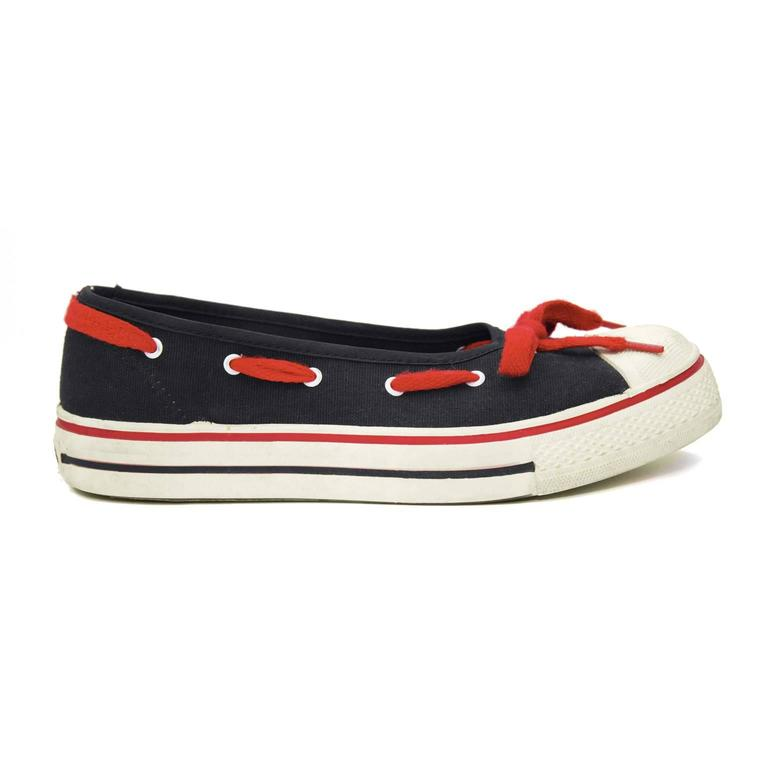 Very early pre OMO 1970's Norma Kamali black and white Converse inspired sneaker flats. From the same era as her iconic high heeled sneaker. White rubber soles and toe caps, black canvas body and red lacing detail around edge finishing in a bow. In