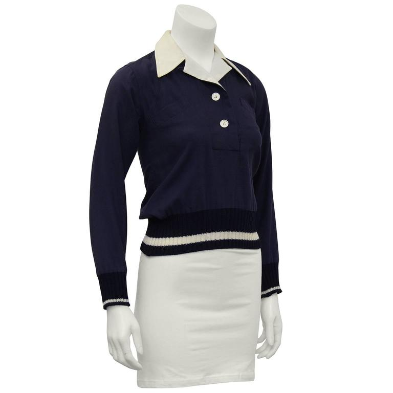 Margaret Howell navy wool gabardine pull over top from the early 1970's. Crisp cream notched collar, two white button opening at the collar. Two slit pockets on the bust and navy and cream knit ribbed cuffs and hem. In excellent condition. Fits like