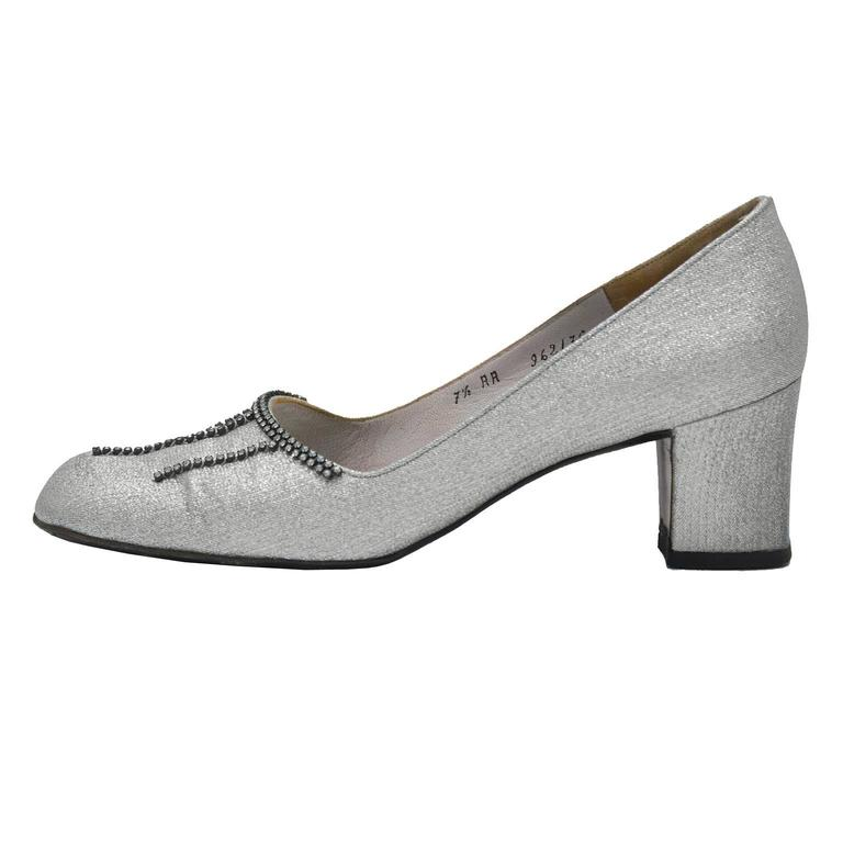 Christian Dior Souliers couture silver brocade round toe chunky heels from the 1960's. The toe of the shoes feature diamante detail and the insole is covered in a matching silver leather. Covered low heel with slight signs of wear. Marked a 7.5 AA