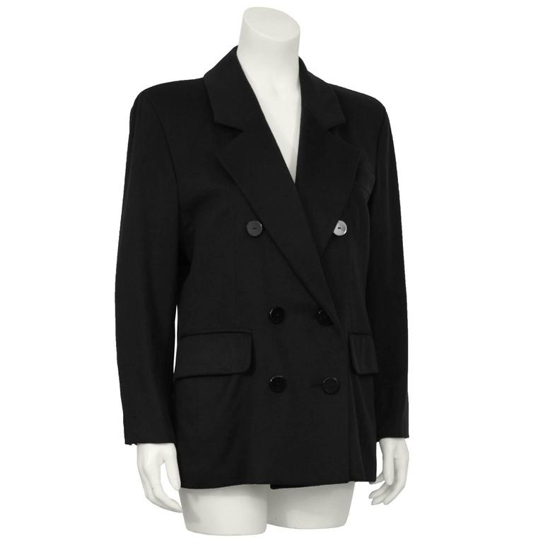 Classic double breasted cashmere blazer from Yves Saint Laurent made in the 1980's. Nothing more versatile than black cashmere to finish off today's day to evening apparel. In excellent condition fits like a US size 6.