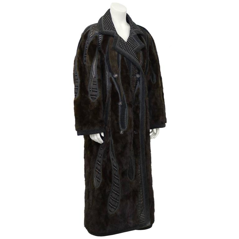 1990's unique wearable art by Koos Van Den Akker Couture. Winter weight, double breasted, drop shoulder Chesterfield shape with hand designed patchwork inserts of deep brown mink, black and cream wool checked fabric, brown leather and suede along