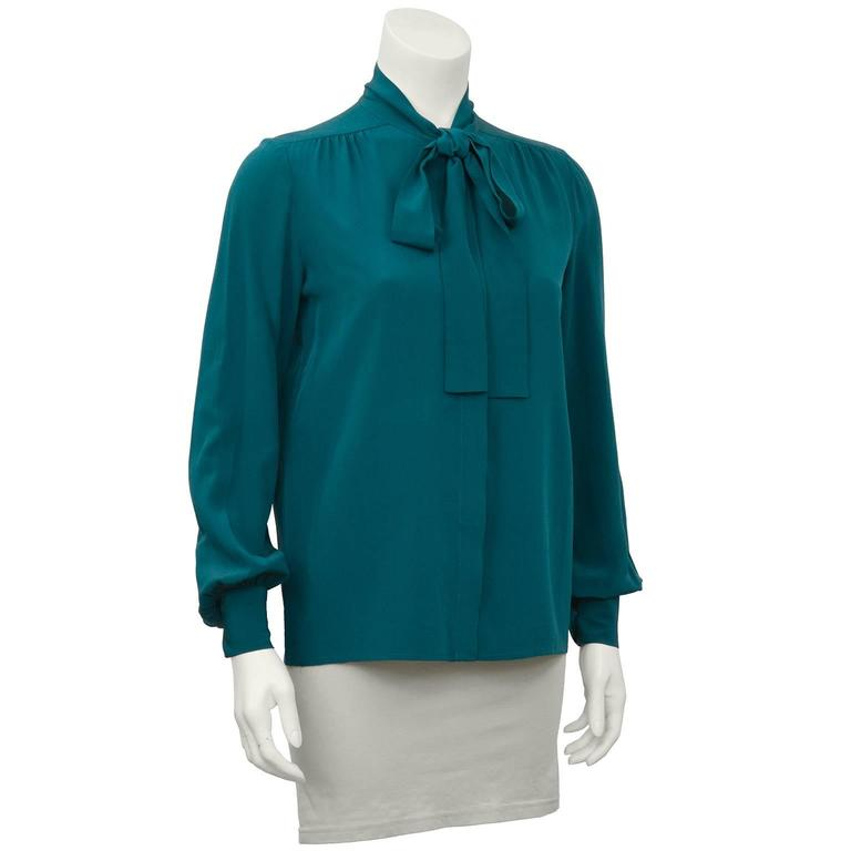 """Chanel 1980's silk button front pussy bow shirt in green. Excellent condition, fits like a US size 4.  Shoulder 17"""" Sleeve 15"""" Bust 36"""" Waist 34"""" Length 25"""""""