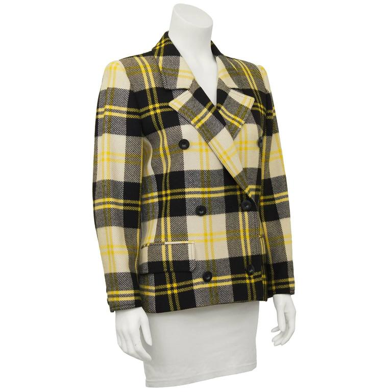 1990's Valentino wool plaid double breasted blazer. Chic cropped fit hitting just mid hip. Double breasted, fitted jacket with notched collar, and half belt in the back. Two flap pockets just below the waist. Modern look, no power shoulder. Fits