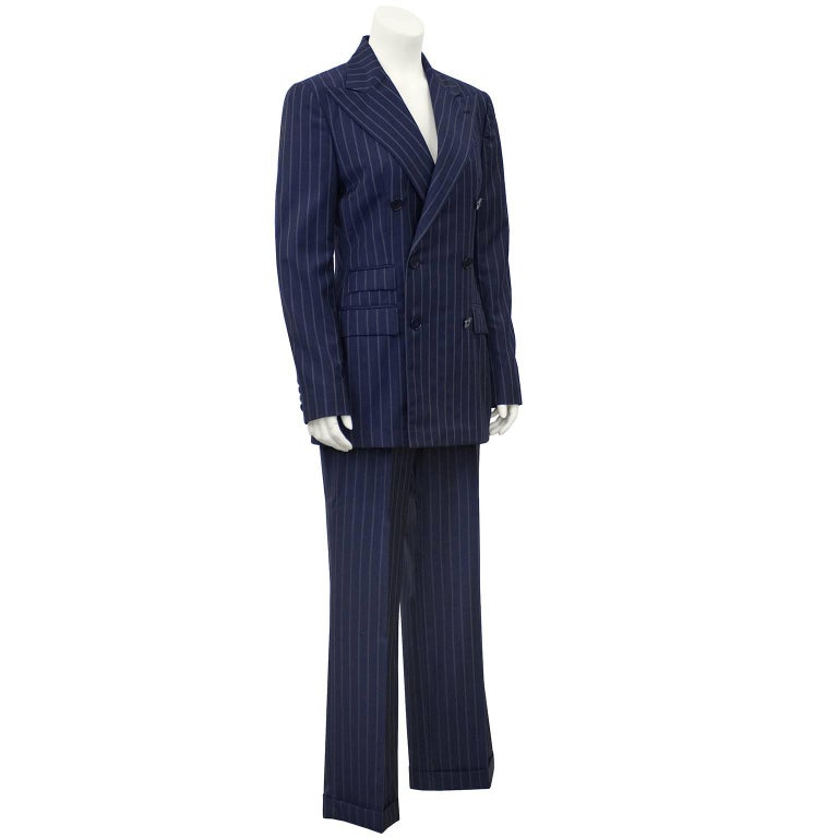 1990's Ralph Lauren Collection Classics navy blue and grey light weight wool pin stripe double breasted pant suit. Blazer features exaggerated collar and 3 flap pockets. Pants are high waisted, pleated and cuffed. Excellent vintage condition. Ralph