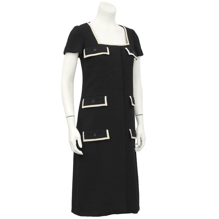 Quintessential 1960's Galanos black wool shift dress with faux flap pocket details and cream wool trim. Square neckline with invisible button closures down front centre. Excellent vintage condition, fits like a US 4-6. perfect fall fashion
