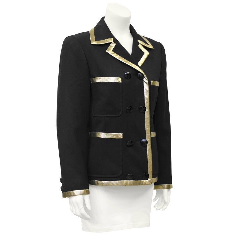 "1980's Valentino black wool double breasted jacket featuring gold lurex trim, black high shine round buttons and 4 patch pockets. Excellent vintage condition. Fits like US 6.   Sleeve 24"" Shoulder 17"" Bust 40"" Waist 36"" Length"