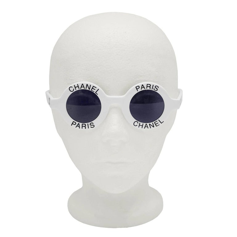 Widely photographed Chanel Paris logo round sunglasses from the 1990's. White with black Chanel Paris on both eyes and CC logo on arms. All other Chanel marking on interior of arms. Highly sought after, original retail price $6000 USD. Worn by