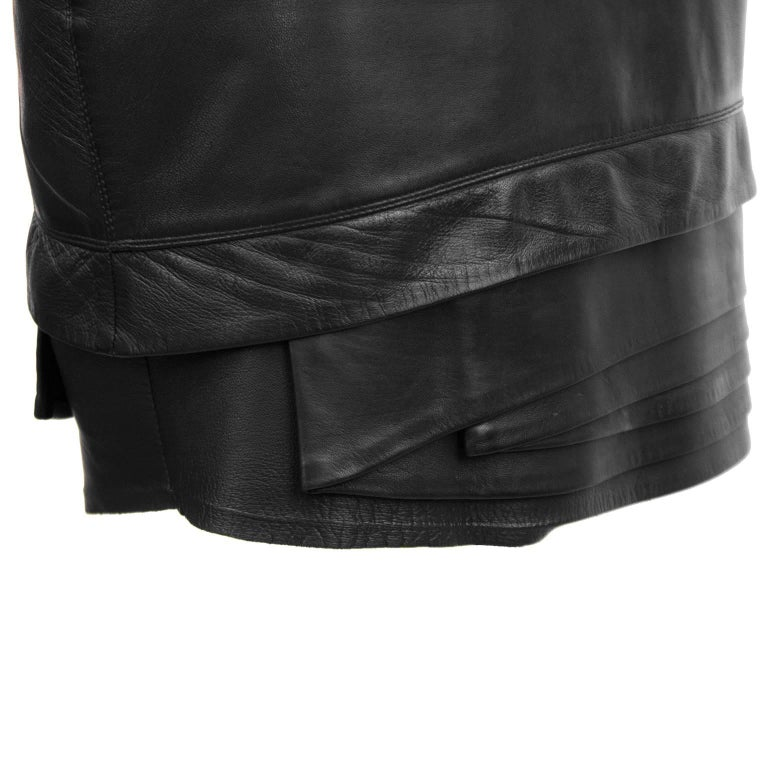 Women's 1980's Gianni Versace Black Leather Skirt with Tiered Hem Detail For Sale