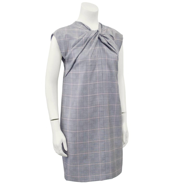 Gucci plaid mini dress from the 1990s. The twisted and gathered neckline is very reminiscent of Balenciaga and the short, shift style makes it playful. Side seam pockets, slight cap sleeve and zips up the back. Marked an IT 40, fits like a US 2-4.