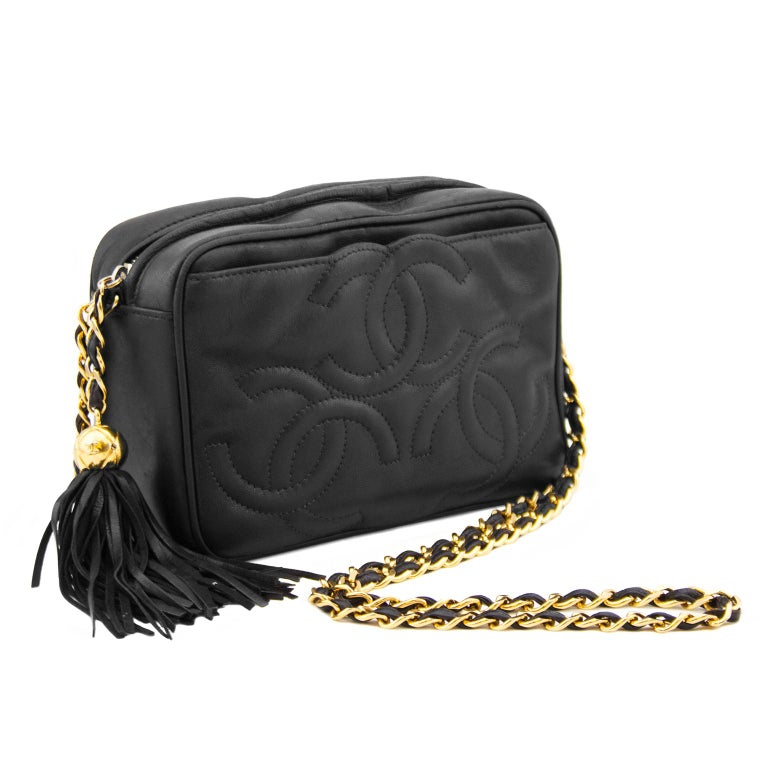 64f55e271ee47d Fabricated from buttery soft black lambskin leather, this triple  interlocking CC logo embossed shoulder bag