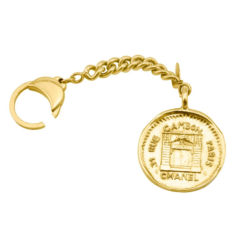 1984 Chanel Rue Cambon Stamped Coin Keychain For Sale