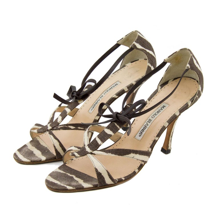Manolo Blahnik zebra canvas scrappy heels with dark brown leather ankle tie. The shoes are in very good vintage condition with some signs of wear. Marked a IT 39, bottoms have been resoled.