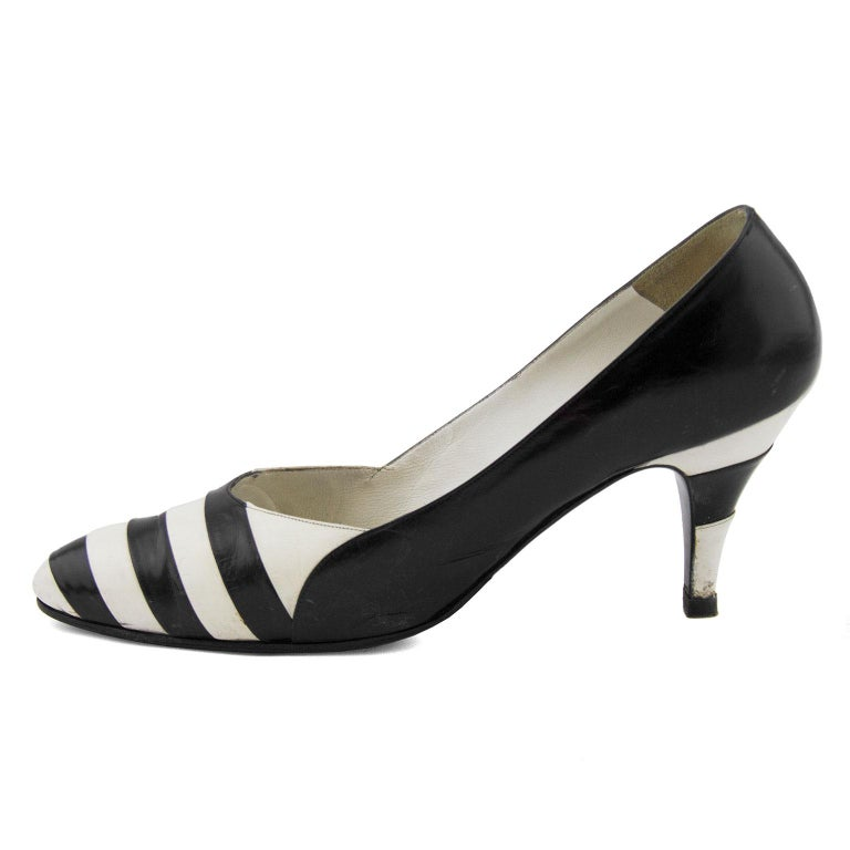 Black and white striped leather pumps from Susan Bennis Warren Edwards. The heel is also covered in black and white leather stripes. In good vintage condition with wear to the toe box where it would naturally crease with wear, and some scuffing on