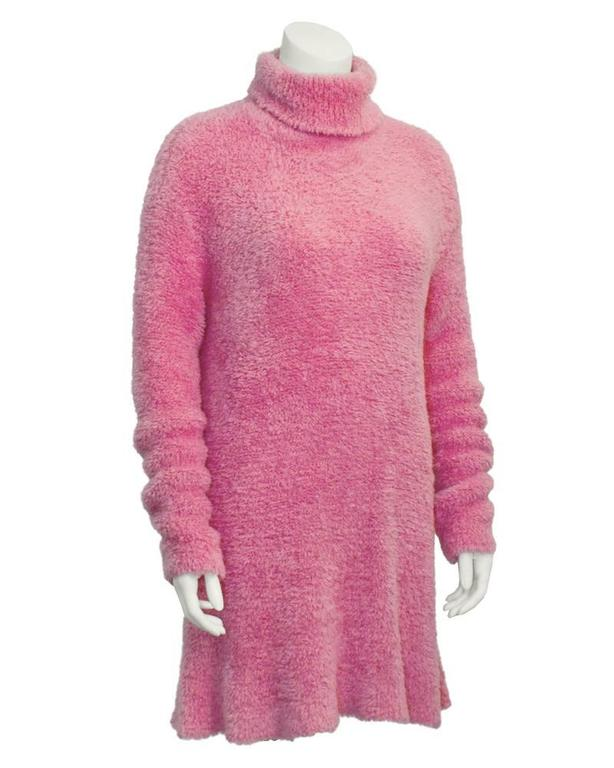 Super cute bubble gum pink, Isaac Mizrahi long sleeve turtleneck tunic style top from the 1990's. Made from a chenille style polyester knit. Extra long sleeves can be cuffed or scrunched. Has a loose, dress like quality. Can be worn over jeans with