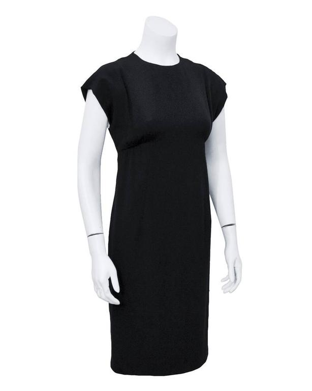 Cute and chic 1960's Geoffrey Beene black  silk crepe cocktail dress. Empire waist and cap sleeve. Perfect for nearly any occasion. Invisible zipper closure up back. Excellent vintage condition. Fits a size 2-4 US.