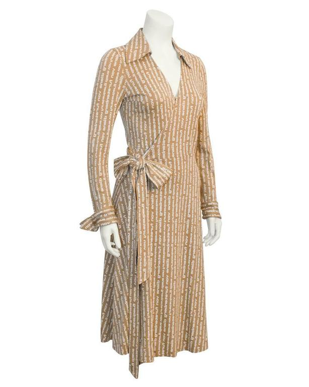 Original edition 1970's DVF wrap dress in cotton jersey made with the the Diane Von Furstenberg logo printed fabric. V-neck, tie waist, iconic fashion piece in excellent vintage condition. Some things never change for a good reason. Fits like a US