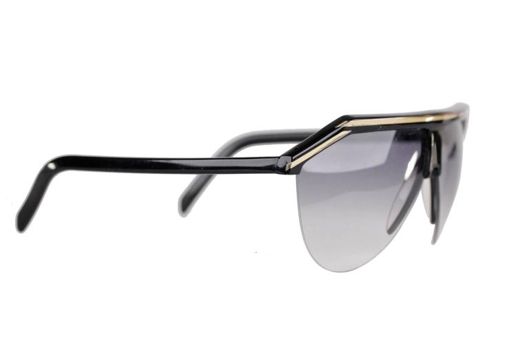 - Vintage Sunglasses of Versace from the 80s  - Black & Gold Tone Frame  - Half-rimmed frame  - Gradient Lenses  Condition: A :EXCELLENT CONDITION - Used once or twice. Looks mint. Imperceptible signs of wear  Condition details: minimal