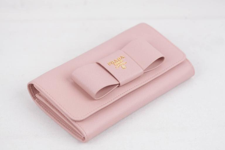 2d765f939476 Saffiano leather flap wallet with leather bow on the front - Colr. Pink (
