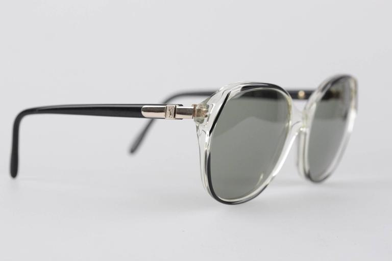 - Vintage YVES SAINT LAURENT oversized sunglasses  - Transparent frame, with black finish on the front, and black & gold arms  - model: VIRGILE 56/18 800  - MINT 100% UV excellent quality GREEN lens  - Made in France  Any other detail