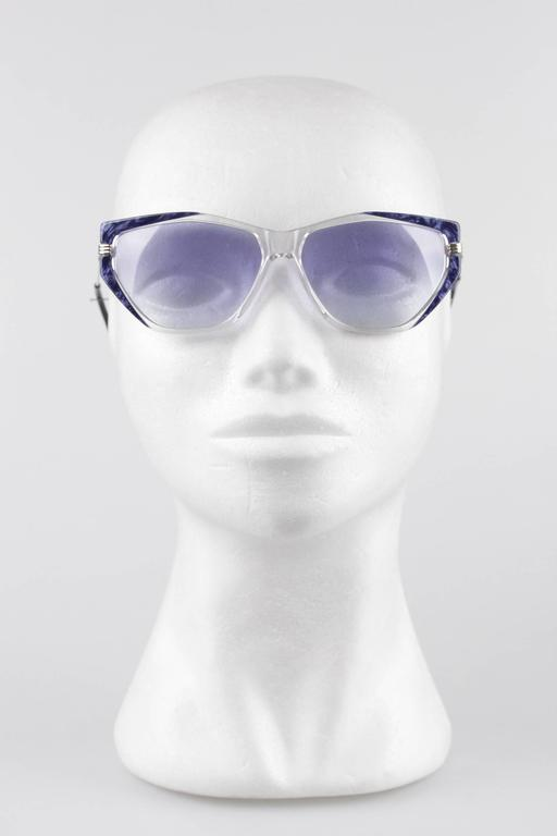 - Vintage YVES SAINT LAURENT sunglasses, Made in France  - mod: EUTERPE - 60/13 - 710  - Clear frame with Blue Marbled design on the sides. Gold metal arms  - Light Blue MINT 100% UV lens  - Made in France  Any other detail which is not