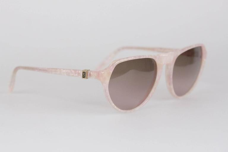 - Vintage YVES SAINT LAURENT sunglasses, Made in France  - mod: PRIAM - 58/16 - 378  - Pink Marbled frame  - Light Brown MINT 100% UV GRADIENT lens  - Made in France  Any other detail which is not mentioned may be seen on the item