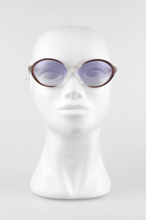- Vintage YVES SAINT LAURENT sunglasses, Made in France  - mod: IKARIA - 56/15 - 341  Brown and clear Cat-Eye frame, with rhinestones on the top & on the sides  - Light Blue   MINT 100% UV lens  - Made in France  Any other detail which is