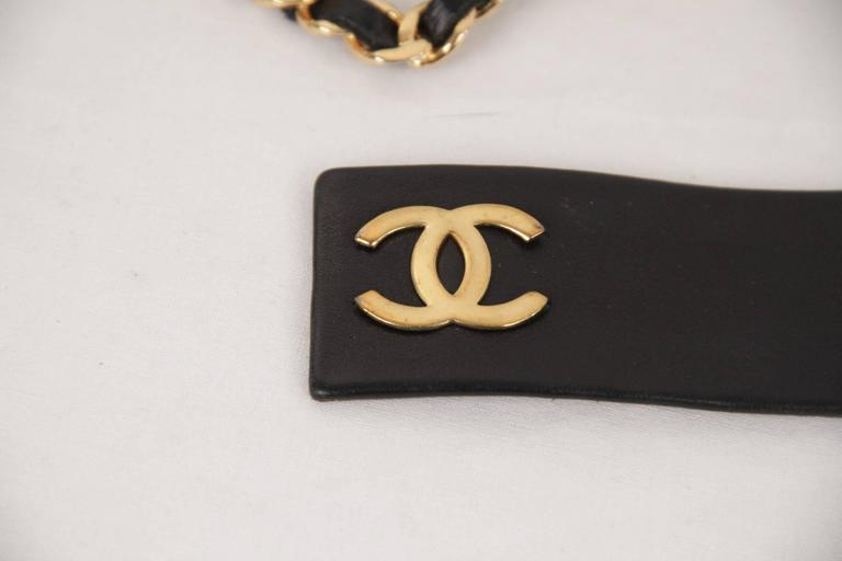 - Vintage leather & gold metal chain belt by CHANEL   - Color: Gold / Black  - Gold metal CC - CHANEL logos  - Interwoven chain buckle closure  - Total lenght: 33 1/4 inches - 84,4 cm   - Size: 70/28  Logos & tag: ''CHANEL 2 CC 6 - Made in