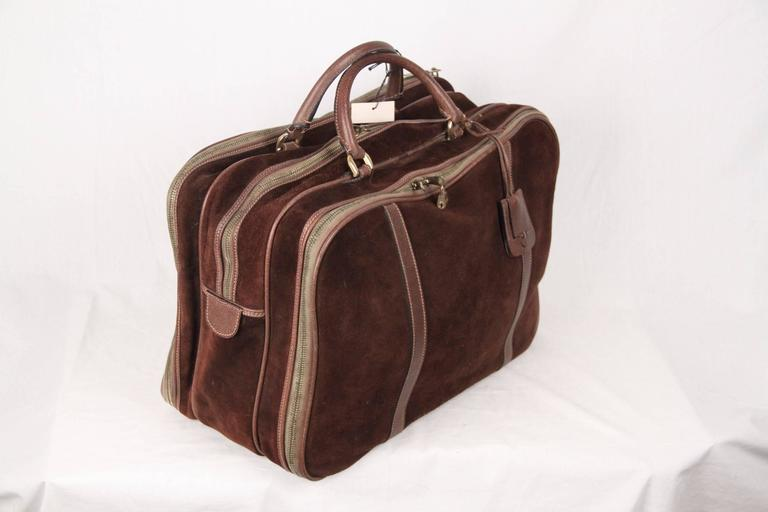 aa6eb2aa1af9 Vintage GUCCI travel bag crafted in brown suede with genuine leather trim.  3 main compartments