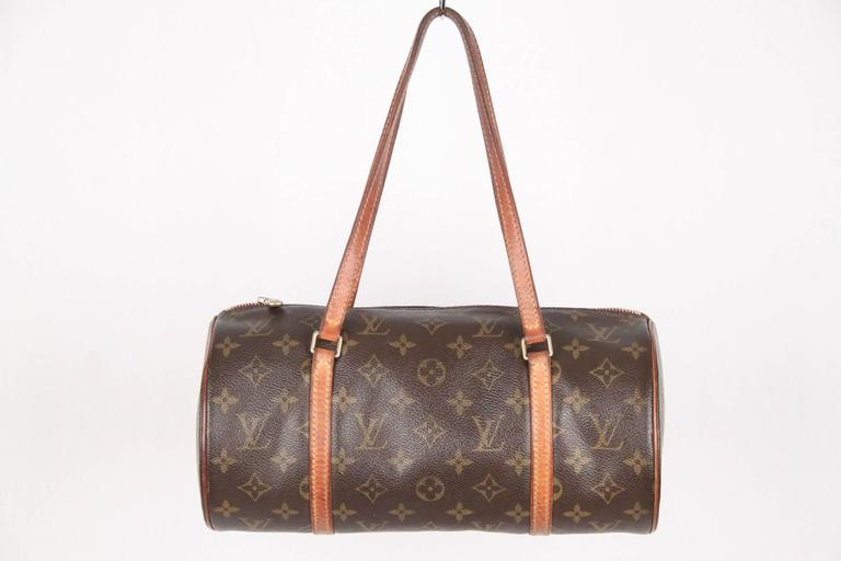 Gorgeous Louis Vuitton 'Papillon' Bag in monogram canvas. The classic rounded shape with two straps is supposed to take the form and spirit of the butterfly ('Papillon' in French). It was originally designed by Henri Vuitton in 1966 and has become