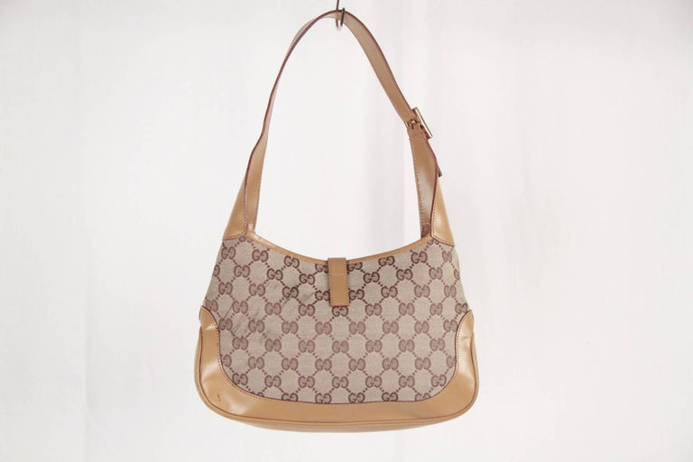 a3e0e825cb9c Classic and stylish is this Gucci Jackie O Hobo pefect for any occasion.  Beige monogram