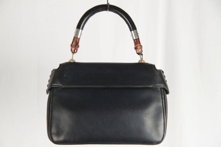 ab7ff6e0079 Blue genuine leather - Looping top handle with bamboo accents - Front flap  woth bamboo