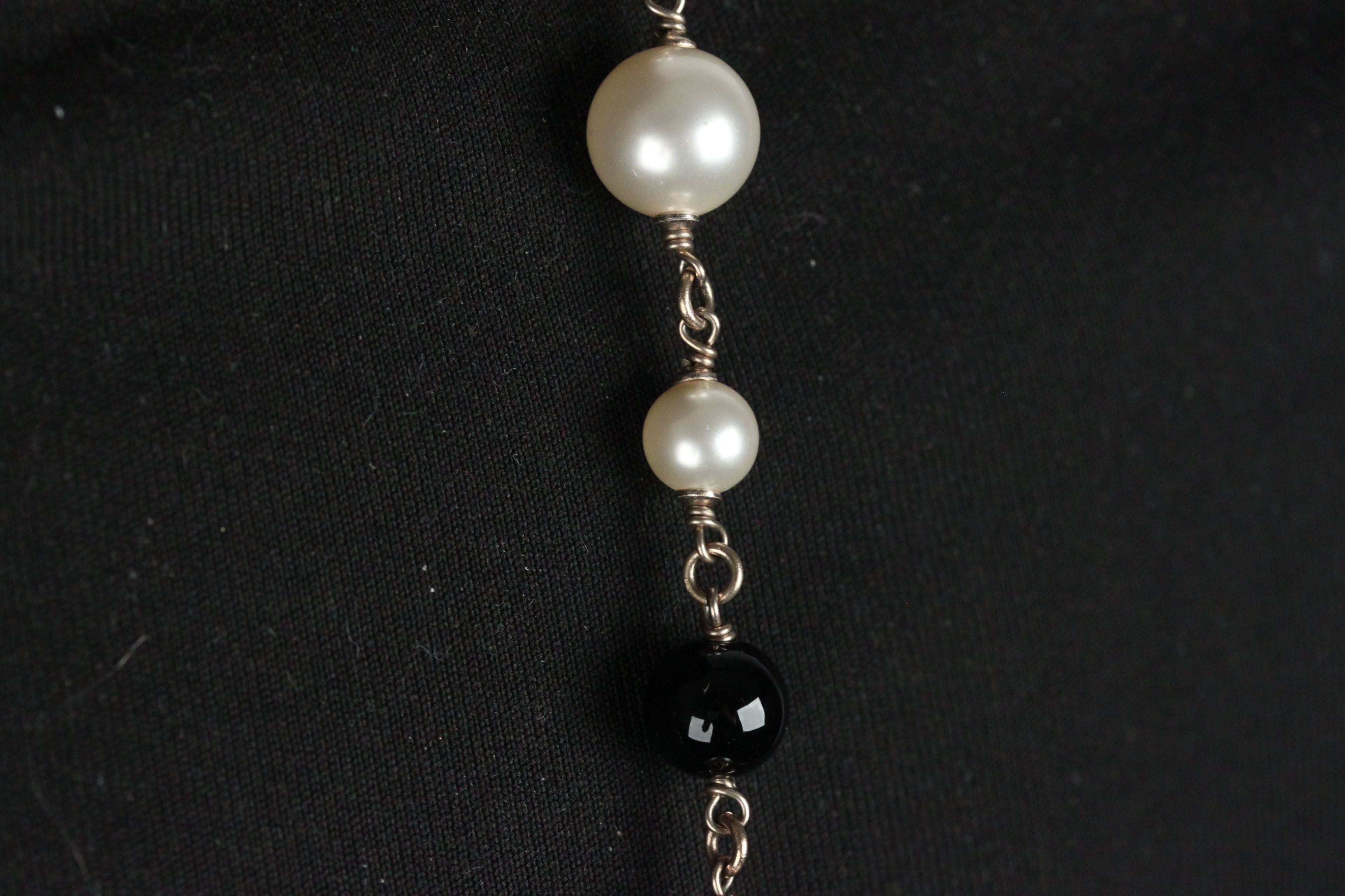 c8a343893ae CHANEL Black and White Long Beaded CAROUSEL NECKLACE For Sale at 1stdibs