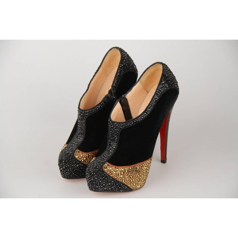 - Christian Louboutin platform ankle boots - Model: 'Laelia Strass 140'  - TBlack velvet embellished with black and gold-tone Swarovski crystals - Embossed Crocodile look leather covered heels - Zip closures on the sides - 5.5 inches - 14 cm covered
