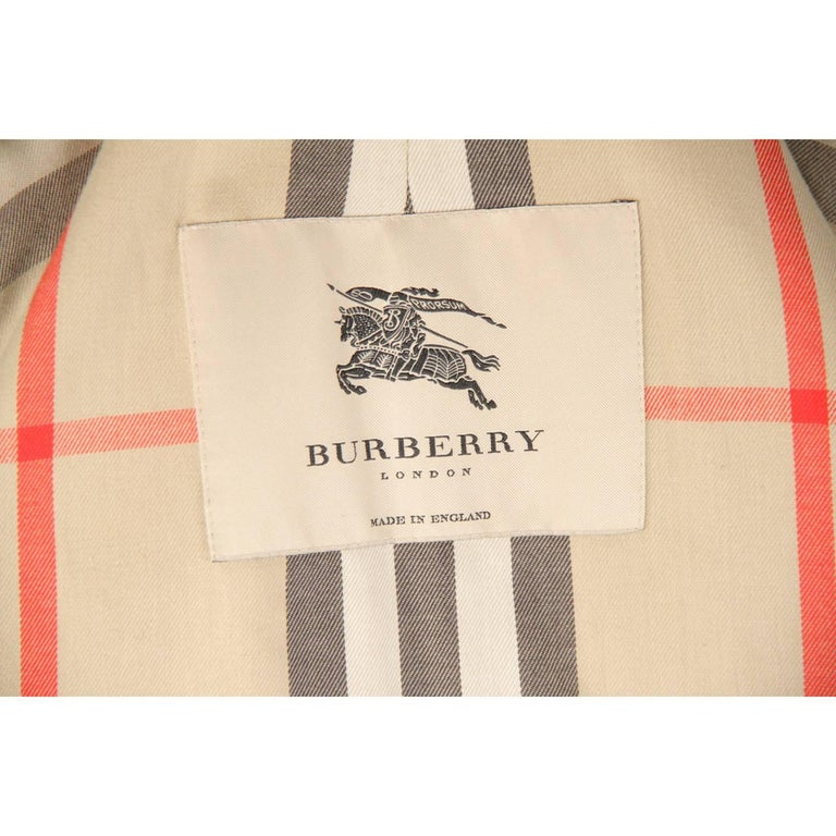 - Burberry classic trench coat - Color: Tan  -Composition: 51 % cotton, 49% polyester, 1%  - Single-breasted design  - Button closure  - Dual side pockets  - Center rear vent  - Fully lined with signature lining  - Size: 52 R (The size shown for