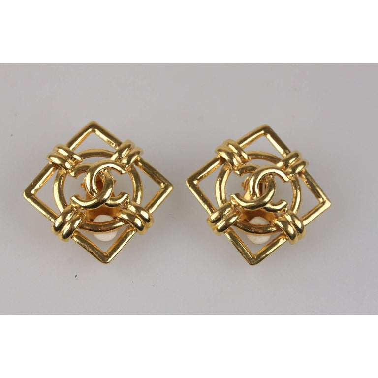 Vintage square clip on earrings in gold metal by CHANEL. 'CHANEL 2 - CC  - 9 -  Made in France' oval tag on the reverse of the earrings.