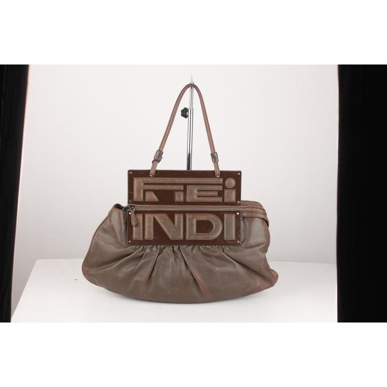 - Fendi Brown Leather 'To You Convertible Clutch Bag'  - Gorgeous draped leather in brown color - Resin panels with a fold over flap (can be carried by the handle or folded over for a clutch look) - Top carry handle - Zip top closure - Brown fabric