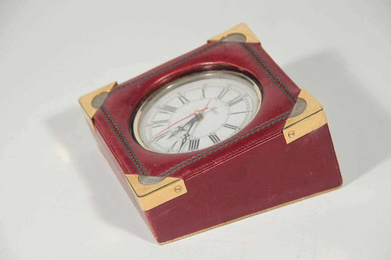 Brand: Vintage GUCCI Made in Italy Desk, leather alarm desk clock watch with roman numbers  Logos / Tags: 'Gucci Italy' on the clock and leather tag on the bottom, GG on the 4 gold and silver metal corners  Condition: (please read our condition